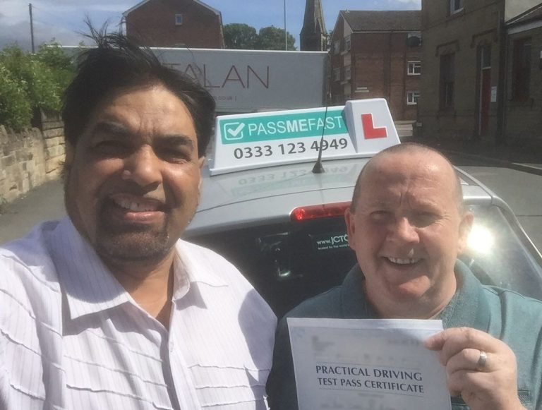 Pass photo featuring PassMeFast learner Carl and instructor Shamsher