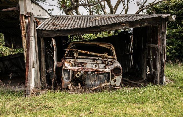 abandoned broken down farm car