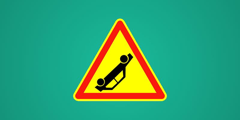 Accident sign depicting overturned car
