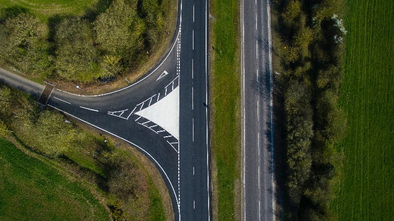 A bird's-eye view of a road junction.