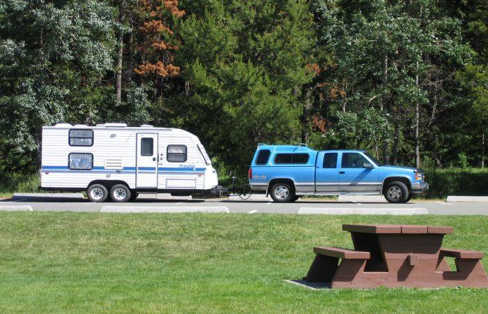 Blue truck towing a caravan