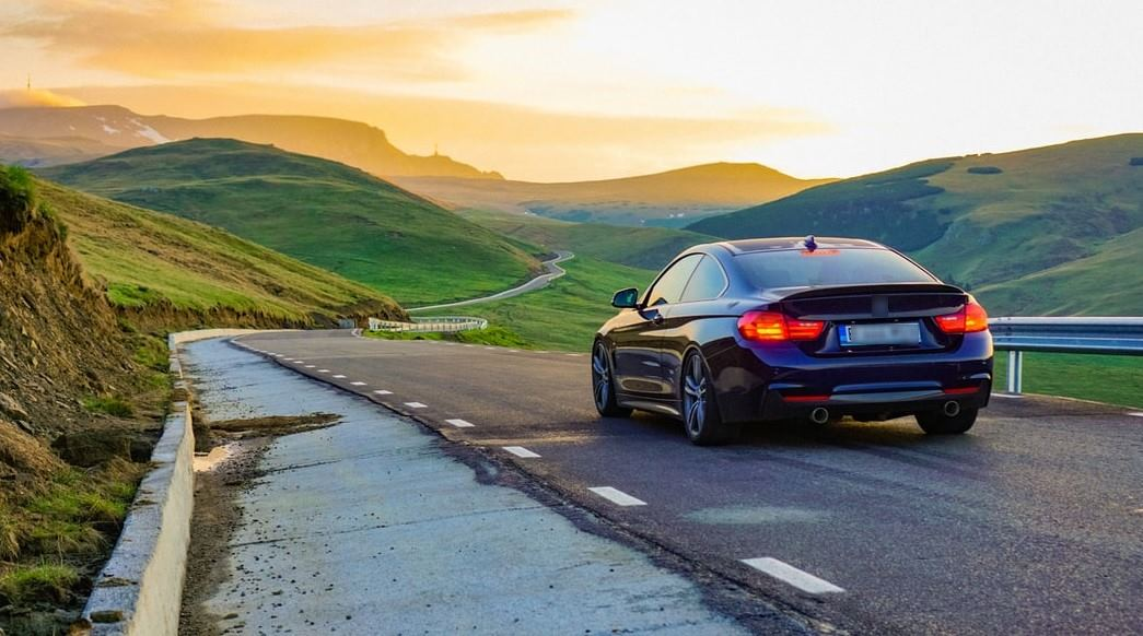 bmw-on-long-winding-hilly-road