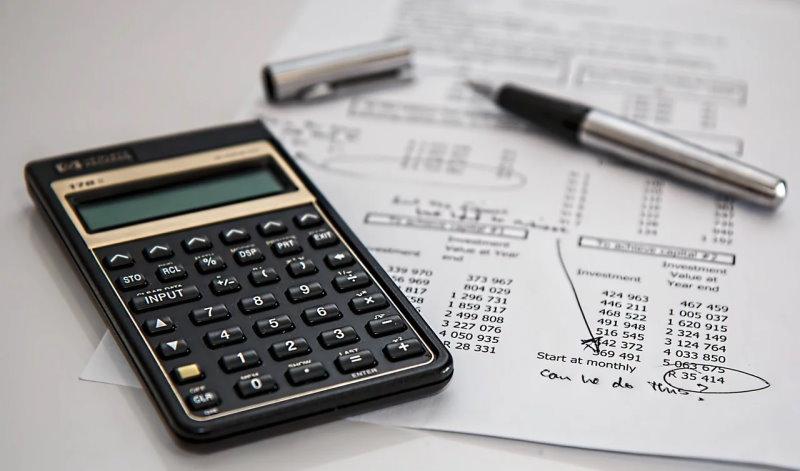 Calculator, document and pen
