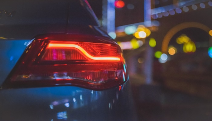 car-driving-at-night-with-rear-light-showing