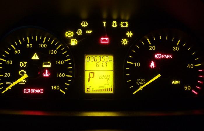 Car dashboard with warning lights