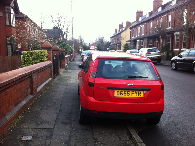 Car parked on a pavement in Chorlton, Manchester