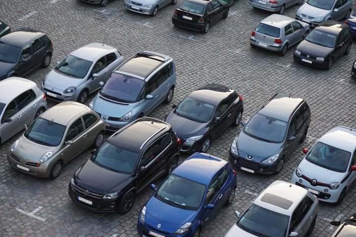 cars parked in bays in car park