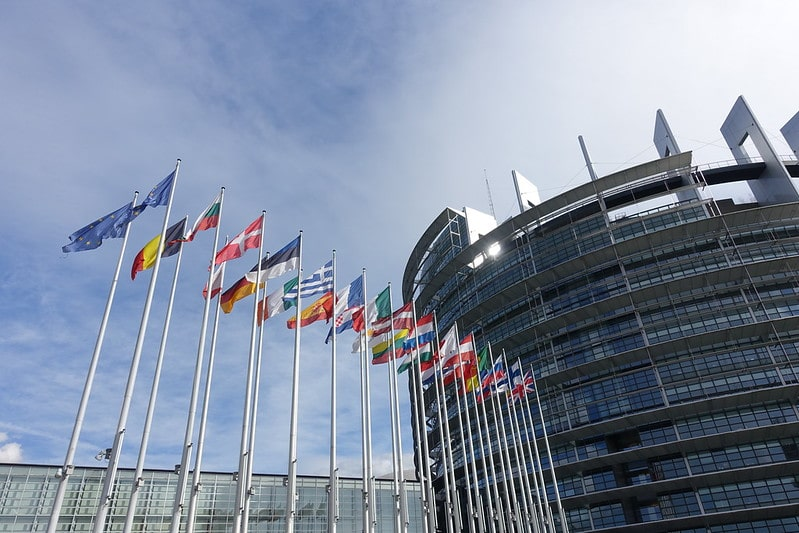 Flags flying outside the European Parliament building in Strasbourg