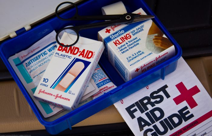 First aid kit containing bandages plasters and scissors
