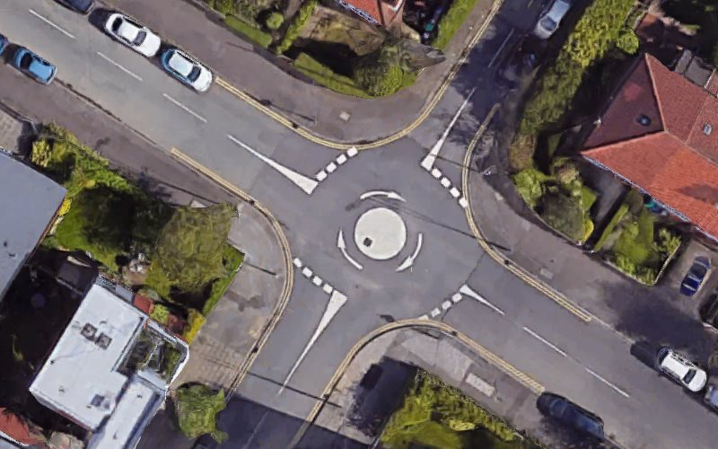 A bird's-eye view of a mini roundabout in Manchester.