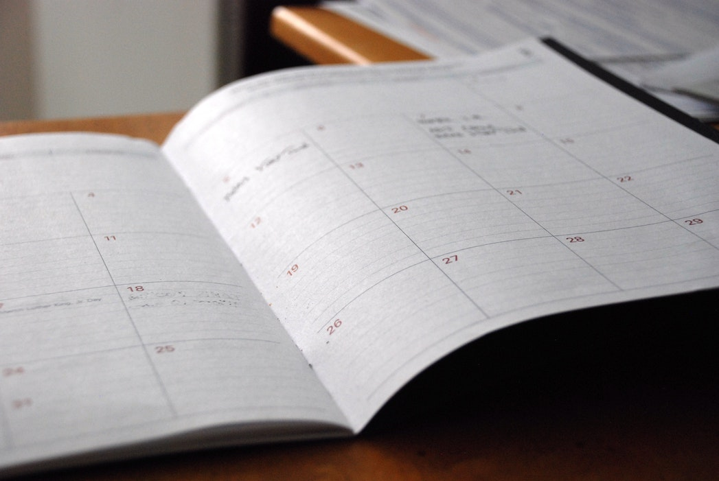 Monthly planner open on desk