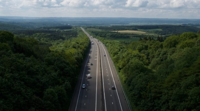 Aerial view of motorway surrounded by trees