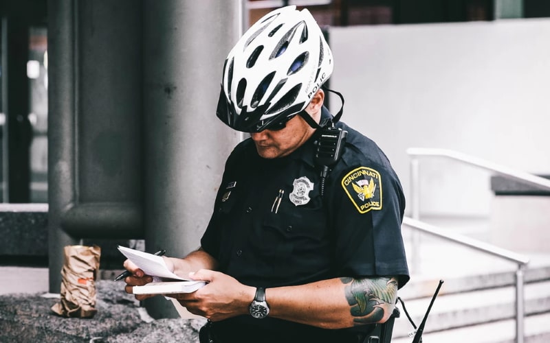 Police officer reading notes