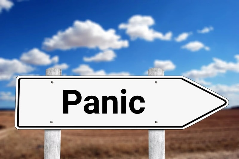 Direction sign with the word 'Panic'