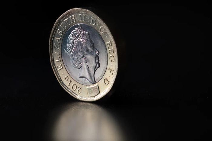 Pound coin against black background