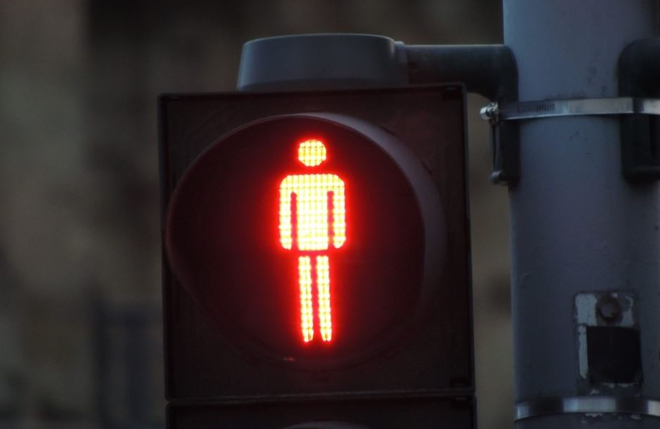 Red man symbol highlighted on traffic light