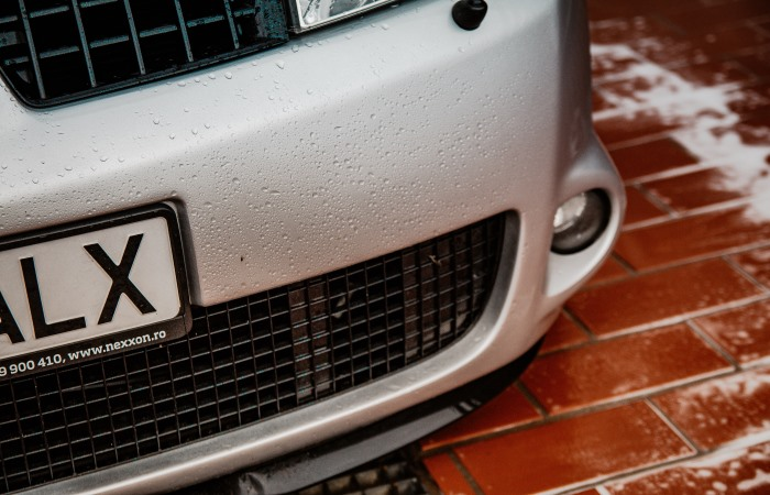 right-hand-shot-of-wet-silver-car