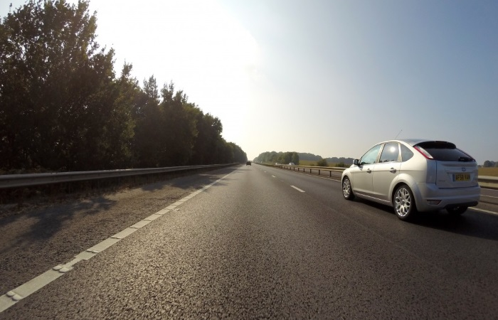 silver-car-driving-on-right-hand-lane-of-motorway