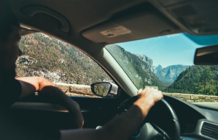 smiling man driving near Yosemite Valley