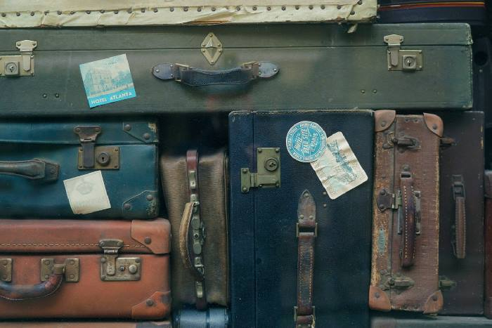 A pile of old suitcases stacked together