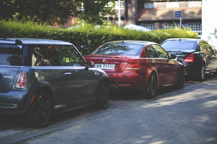 three-cars-parallel-parked-on-road