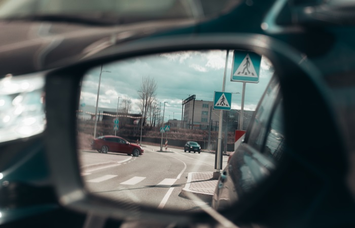 view-of-cars-and-road-in-side-mirror