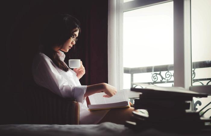 woman-sat-by-window-reading