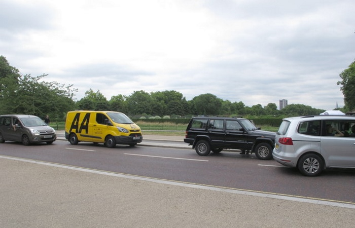 Yellow AA van behind black Range Rover